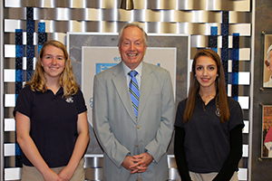 Irene Soteriou and Paige Plucker with a representative of the National Merit Scholarship Program