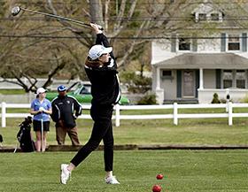 Golfing student