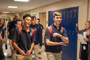 Students walk down a hallway