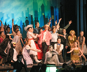 Students performing Mary Poppins on stage