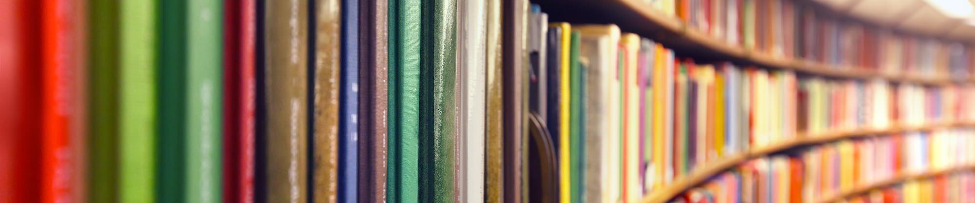 Books on a long curved shelf