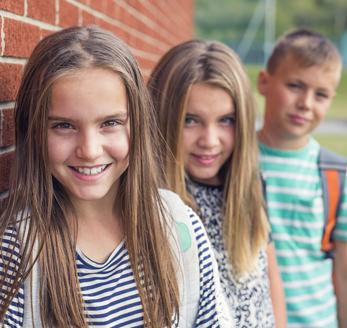 Three smiling students