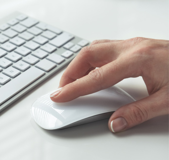 Hand using computer mouse