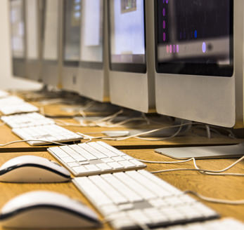 Closeup of desktop computers in computer lab