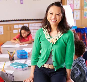 Teacher standing in classroom