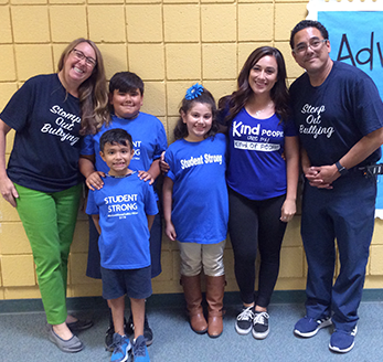 Students pose with staff members wearing anti bullying shirts
