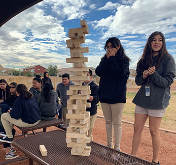 Students play Jenga outside