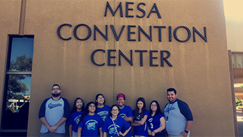 Students and staff pose in front of the Mesa Convention Center