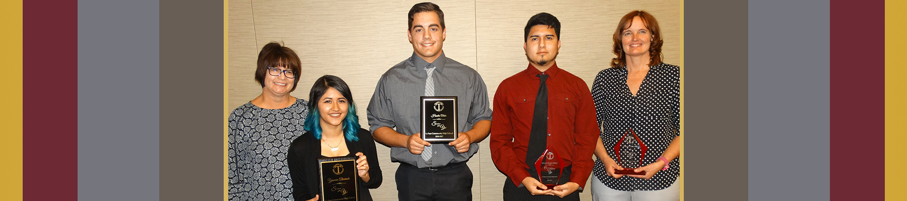 Students with plaque awards