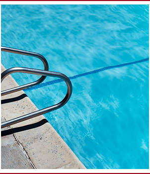 Side view of a pool rail in a pool