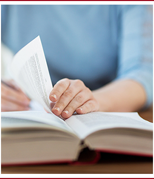 Hands hold a book open