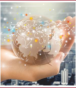 Hand holds a glass globe