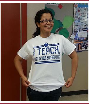 Teacher poses in a hallway