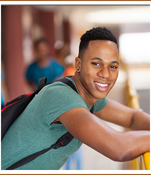 Smiling student wearing a backpack