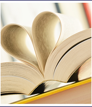 Open book pages form a heart shape