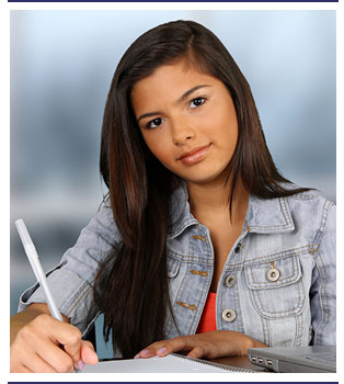 Student poses as she holds a pen