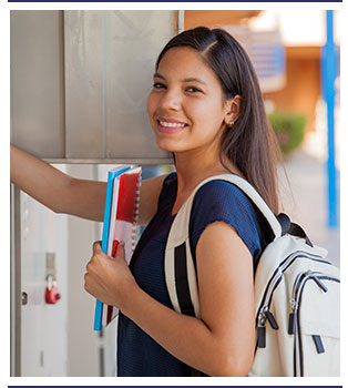 Student wearing backpack grabs notebooks out of her locker
