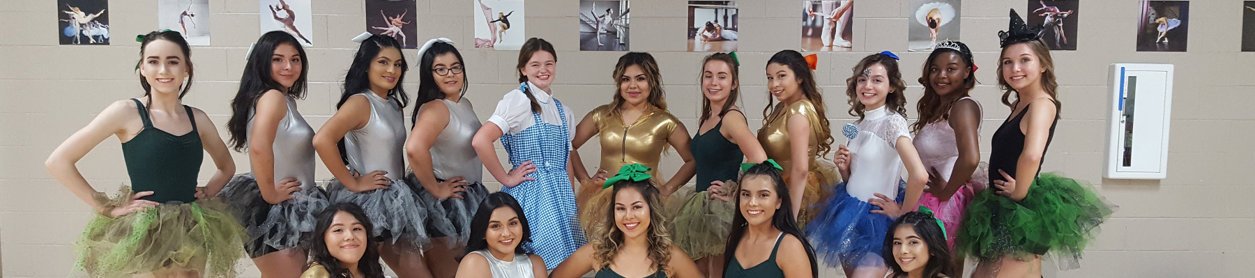 Students posing in play costumes