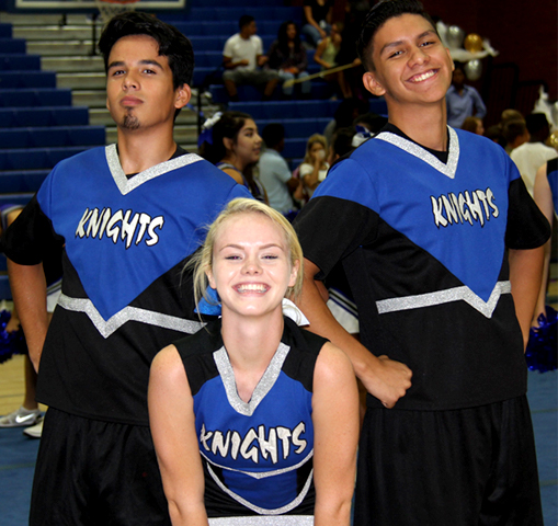 two male and one female cheerleader at pep rally