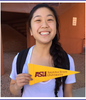 Student holding pennant