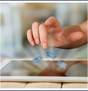hand typing on tablet with email icons
