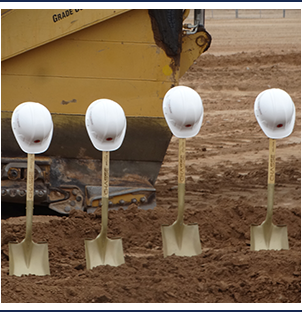 West Point High School construction site with four shovels in the dirt