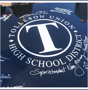 Tolleson Union High School District logo on a plaque signed by leadership team