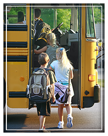 Students getting onto a school bus
