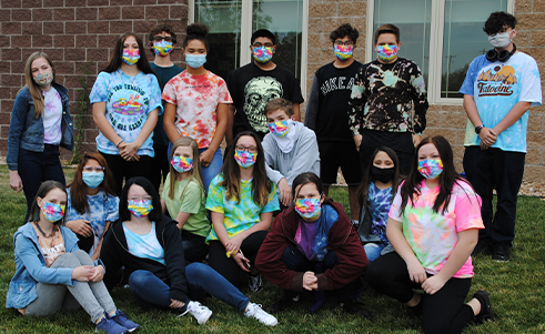 Group shot of students in tie dye face masks
