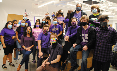 Group photo of students in purple clothes