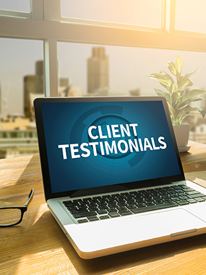 Client Testimonials page on a laptop screen