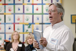 Dr. Robert Enright holding a book