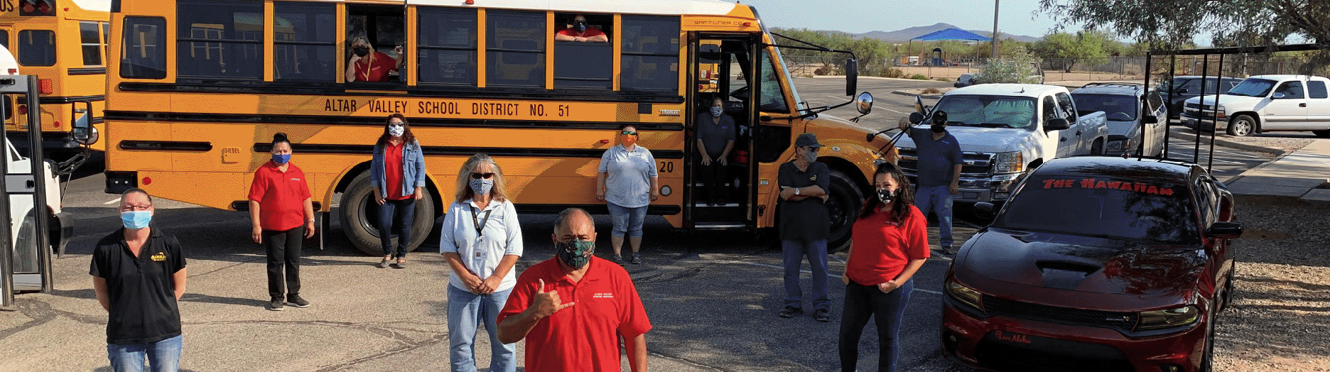 Welcome Back - transportation employees with a bus and masks