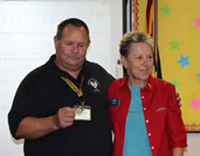 Altar Valley School District Governing Board Vice President Robert Ethridge receives his Challenge Coin
