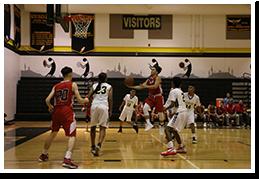 Basketball player shooting a ball into a hoop during a basketball game