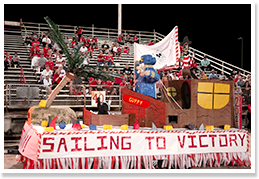 Sailing to Victory float in front of bleachers