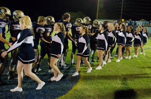 Football players and cheerleaders