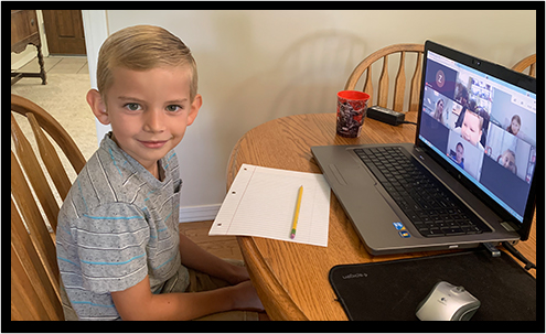 student working on schoolwork from home