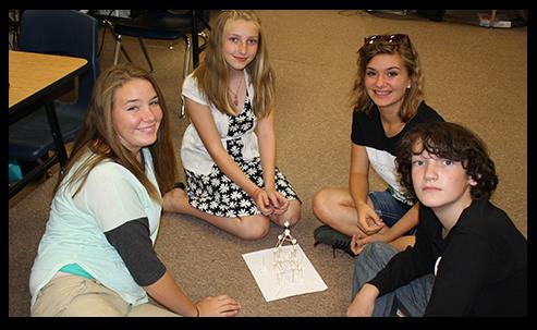 Students sitting on floor