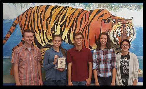 Students with tiger mural