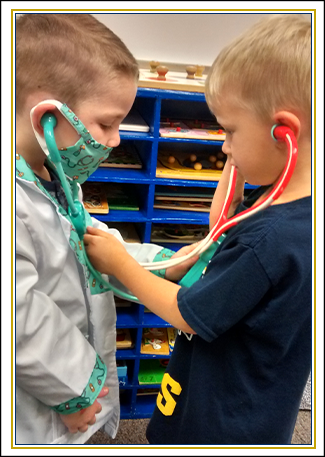 Two male students use play stethoscopes on each other