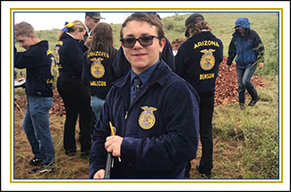 Five cub scouts pose together