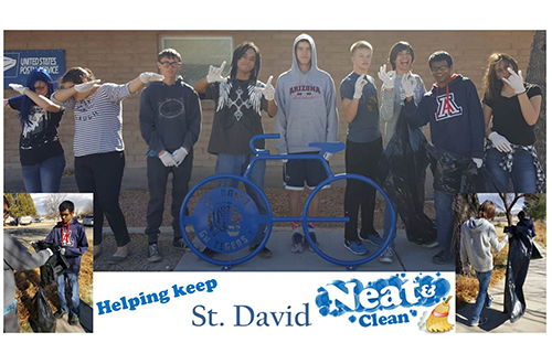 Students helping keep St. David neat and clean.