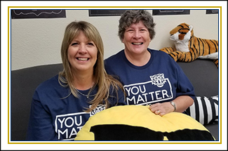 two staff members wearing shirts that say You Matter