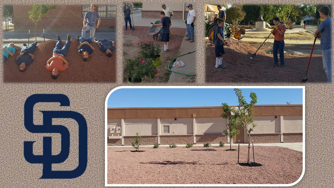 students working on the school grounds
