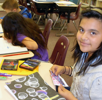 student working on art project
