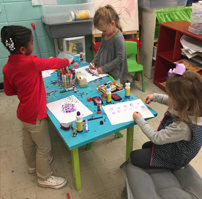 Young students creating artwork