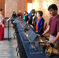 Students playing bells