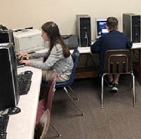 Students using computers and headphones