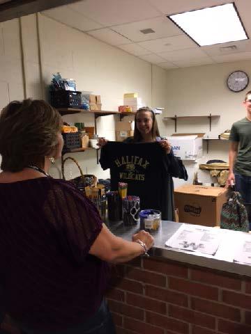 Student holding Halifax Tee Shirt